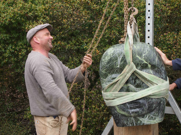 Paul Vanstone installing a stone sculpture