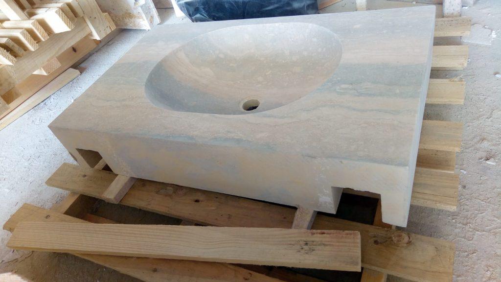 Hidden channels for brackets in back of carved travertine basin